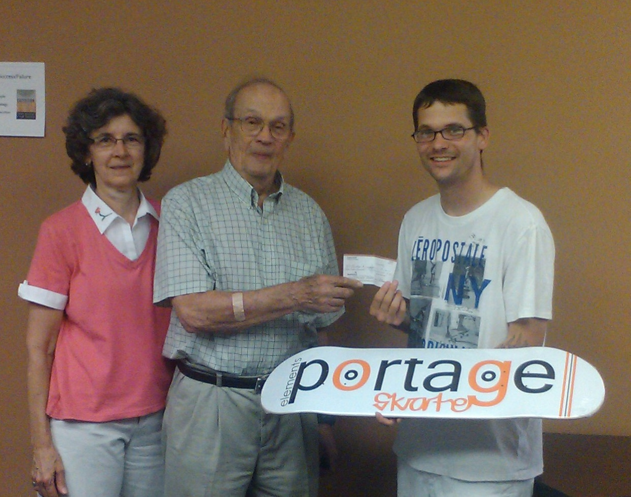 Mr. and Mrs. Frank Petras handing a $1000 donation.