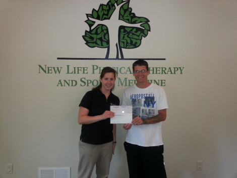 Kyle Little excepting a sponsorship donation for the 2014 skate park marathon.