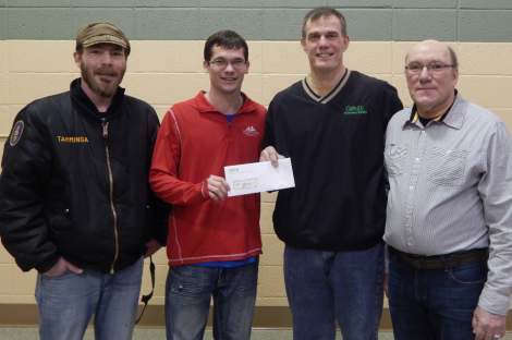 Andrew Tamminga Art Director & Kyle Little President of the PFSP except a donation check from Greg Braatz (dark shirt) and Russ Pollesch employees of Grande Cheese of Wyocena Wisconsin.