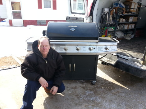 Mike Davis of Portage donating his grill to the Portage family skate park project on 3/1/15